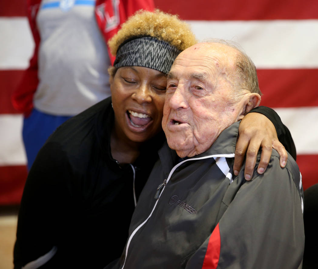 Joe Rosa, of Las Vegas, greets fellow member Jacquie Cottey, 64, of Las Vegas, at his 103rd birthday celebration at 24 Hour Fitness in Summerlin Friday, Dec. 7, 2018. After being the victim of a h ...