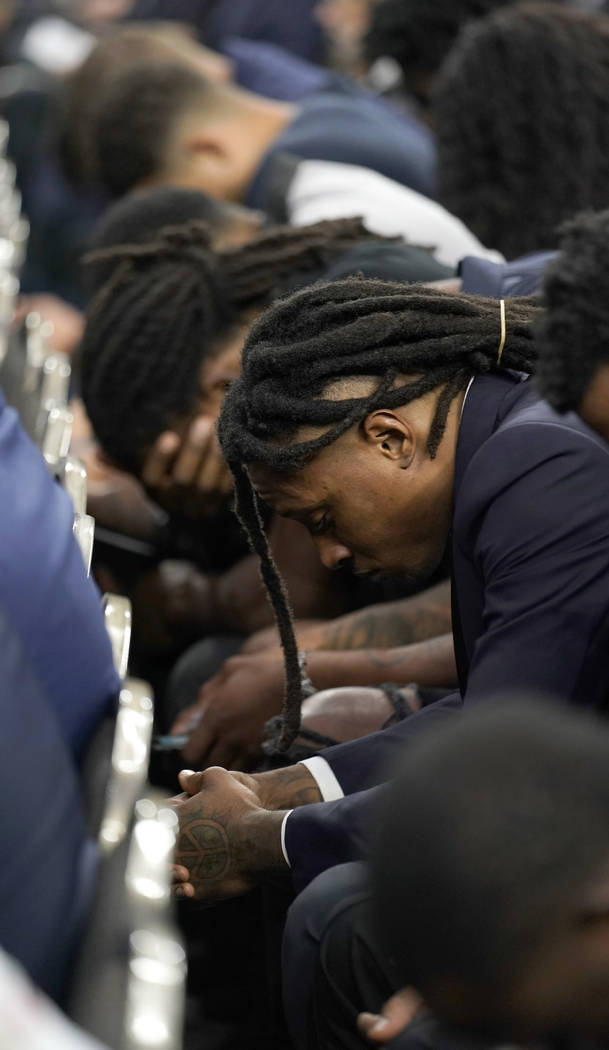 Houston Texans' DeAndre Hopkins bows his head during a prayer at a public celebration of life for Houston Texans owner Robert C. McNair at NRG Stadium, Friday, Dec. 7, 2018, in Houston. McNair, wh ...