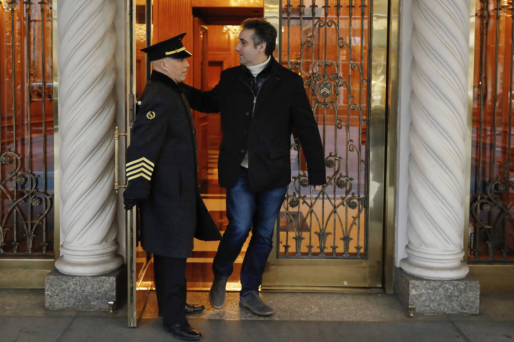 Michael Cohen, former lawyer to President Donald Trump, leaves his apartment building on New York's Park Avenue, Friday, Dec. 7, 2018. In the latest filings Friday, prosecutors will weigh in on wh ...