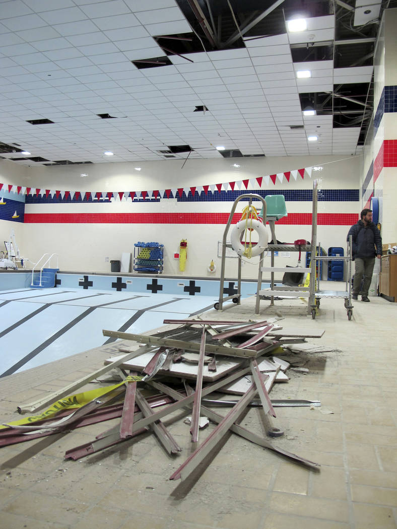 Debris litters the ground at a base pool room damaged by the powerful Nov. 30 earthquake, at Joint Base Elmendorf-Richardson, in Anchorage, Friday, Dec. 7, 2018. The magnitude 7.0 earthquake caus ...