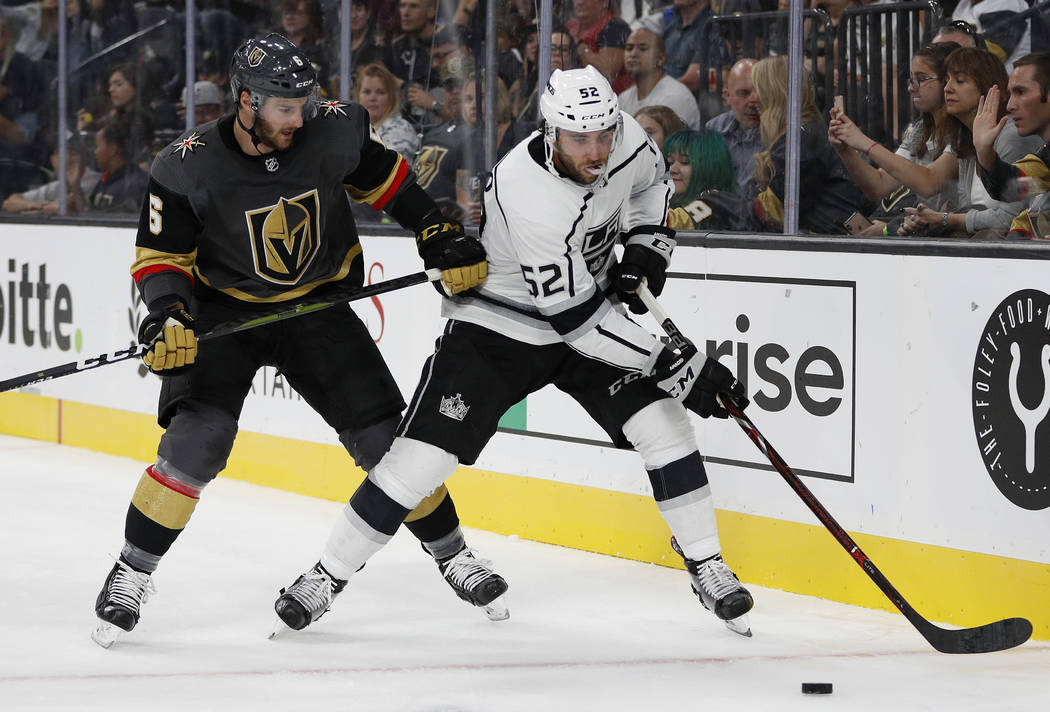 Los Angeles Kings center Michael Amadio (52) vies for the puck with Vegas Golden Knights defenseman Colin Miller during the third period of a preseason NHL hockey game Friday, Sept. 28, 2018, in L ...