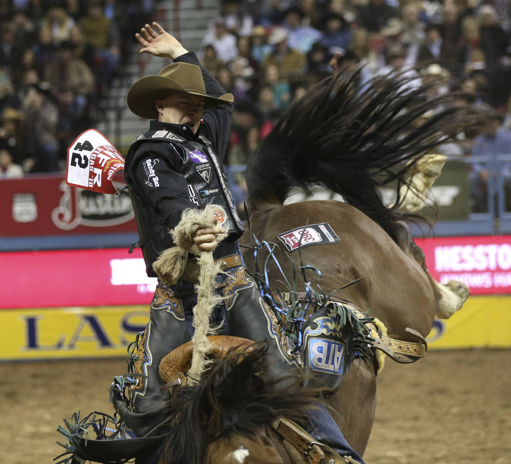 """Zeke Thurston of Canada rides """"Best Hope"""" while competing in saddle bronc riding during the second go-round of the National Finals Rodeo at the Thomas & Mack Center in Las Vegas on F ..."""
