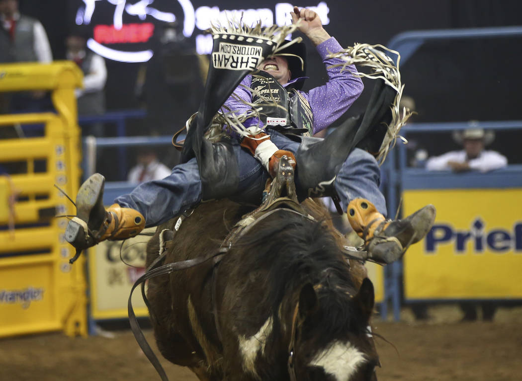 """Steven Dent, of Mullen, Neb., rides """"Uptown Flash"""" while competing in bareback riding during the second go-round of the National Finals Rodeo at the Thomas & Mack Center in Las Vegas ..."""