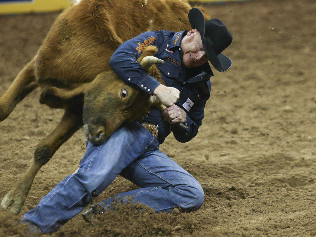 Curtis Cassidy of Canada competes in steer wrestling during the second go-round of the National Finals Rodeo at the Thomas & Mack Center in Las Vegas on Friday, Dec. 7, 2018. Chase Stevens Las ...