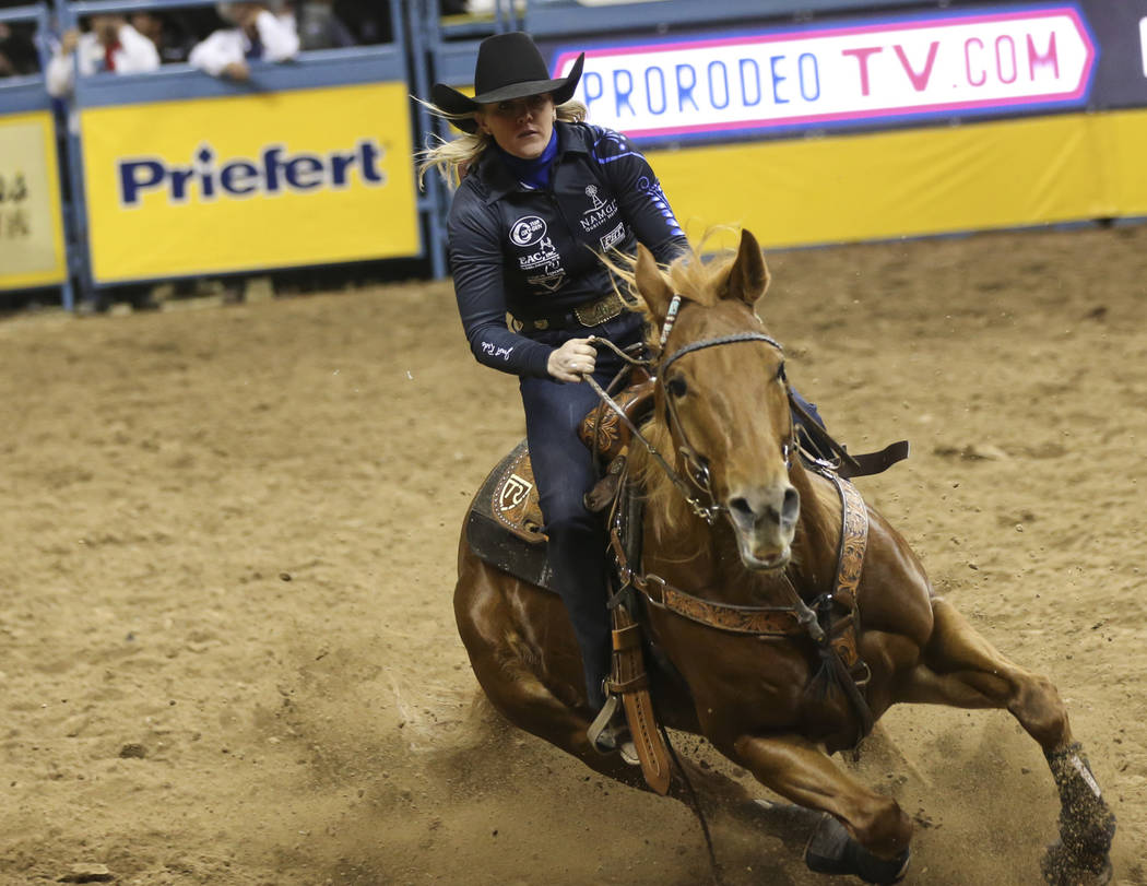 Kylie Weast, of Comanche, Okla., competes in barrel racing during the second go-round of the National Finals Rodeo at the Thomas & Mack Center in Las Vegas on Friday, Dec. 7, 2018. Chase Steve ...