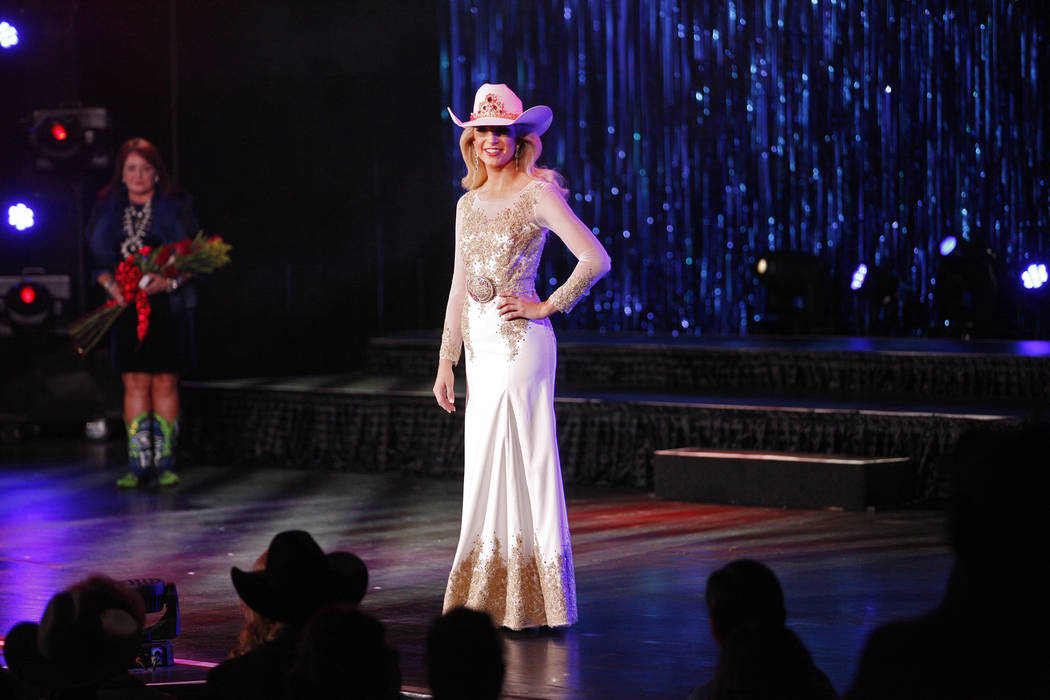 Miss Rodeo America 2018 Kerri Sheffield walks the stage for the last time for her reign at the Miss Rodeo America 2019 at the Tropicana hotel-casino in Las Vegas, Sunday, Dec. 9, 2018. Sunday was ...