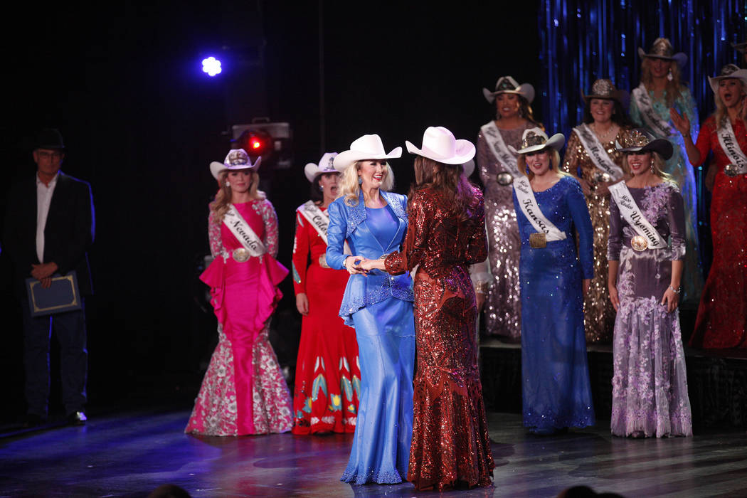 Miss Rodeo Oklahoma Taylor Spears, left, holds hands with Miss Rodeo Mississippi Taylor McNair as they are announced as the last two finalists at the Miss Rodeo America 2019 at the Tropicana hotel ...