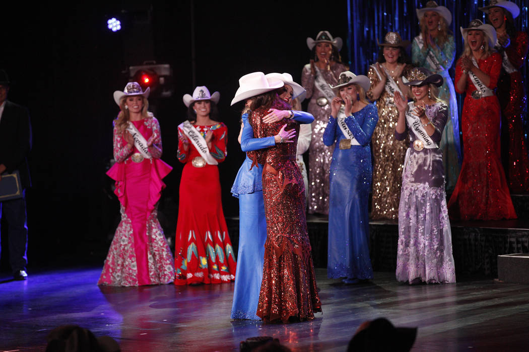Miss Rodeo Oklahoma Taylor Spears, left, hugs Miss Rodeo Mississippi Taylor McNair as McNair is announced the winner at the Miss Rodeo America 2019 at the Tropicana hotel-casino in Las Vegas, Sund ...
