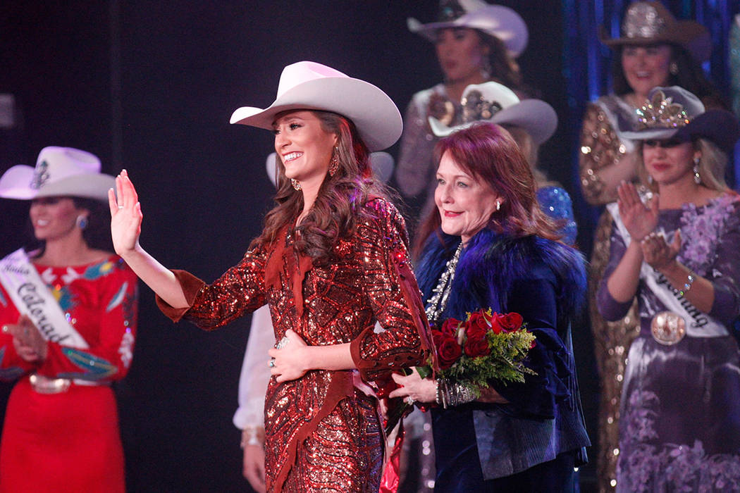Miss Rodeo Mississippi Taylor McNair, second from left, waves to the crowd with Kiki Shumway, executive board president of Miss Rodeo America, third from left, after McNair winning the Miss Rodeo ...