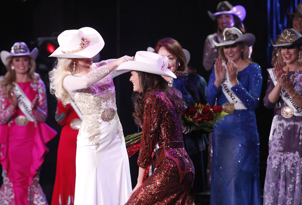 Miss Rodeo America 2018 Kerri Sheffield places a crown on the 2019 winner Miss Rodeo Mississippi Taylor McNair at the Tropicana hotel-casino in Las Vegas, Sunday, Dec. 9, 2018. Sunday was the fina ...