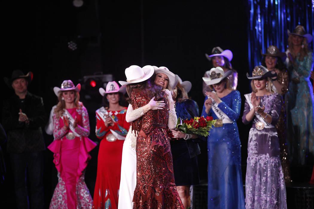 Miss Rodeo America 2018 Kerri Sheffield, left, hugs the new Miss Rodeo America 2019, Miss Rodeo Mississippi Taylor McNair, at the Tropicana hotel-casino in Las Vegas, Sunday, Dec. 9, 2018. Sunday ...