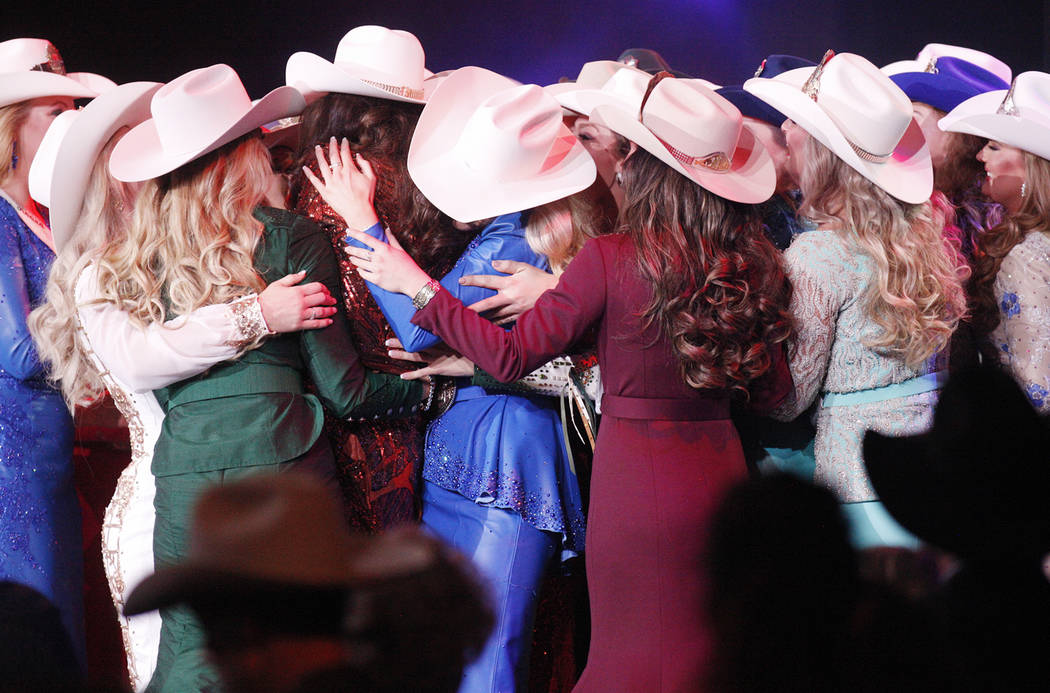 Contestants swarm the winner Miss Rodeo Mississippi Taylor McNair after her win at the Miss Rodeo America at the Tropicana hotel-casino in Las Vegas, Sunday, Dec. 9, 2018. Sunday was the final day ...