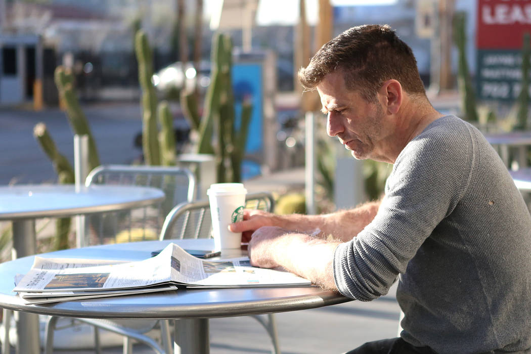Steve Stenberg takes advantage of the sunny weather to read his paper outside the Starbucks in downtown Las Vegas on Friday, Feb 3, 2017. (Bizuayehu Tesfaye/Las Vegas Review-Journal) @bizutesfaye