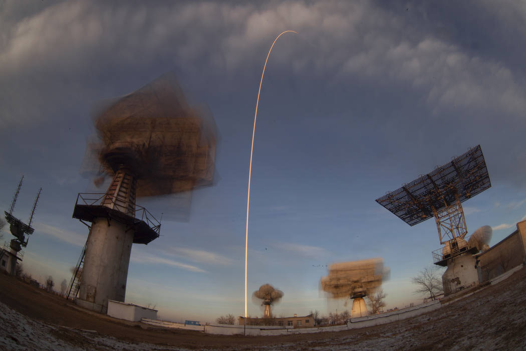 In this photo taken with a long exposure, a Soyuz rocket carrying a new crew to the International Space Station blasts off from the Russian-leased Baikonur cosmodrome in Kazakhstan, Monday, Dec. 3 ...