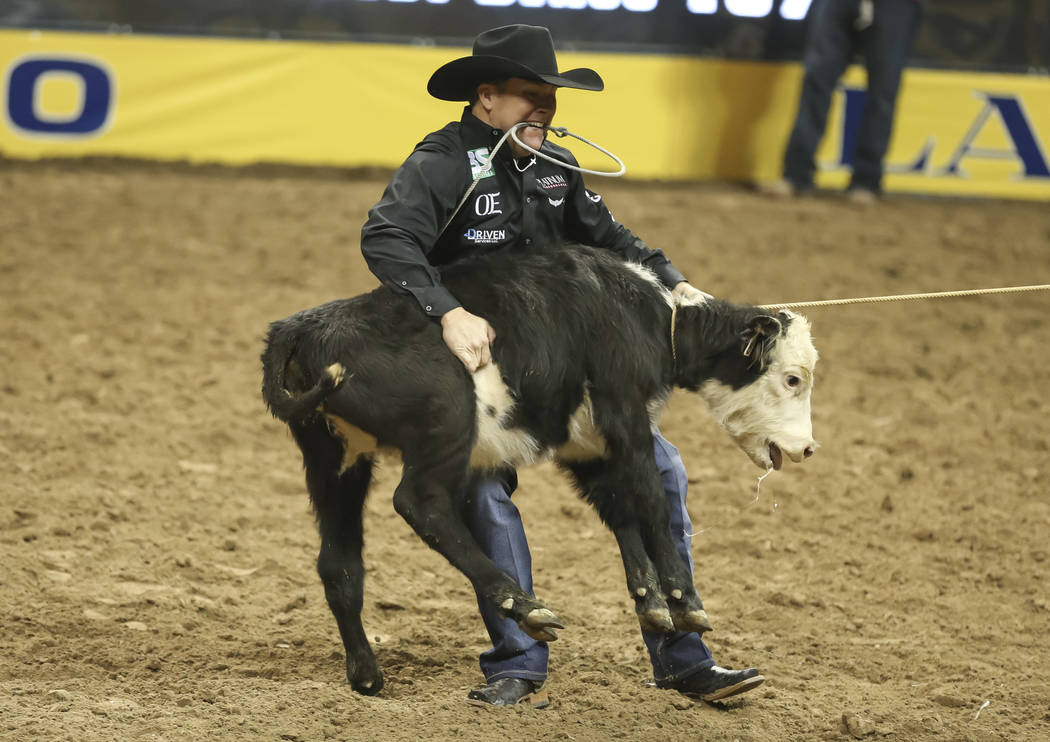 Trevor Brazile of Texas competes in thetie-down ropingduring the third go-round of the National Finals Rodeo at the Thomas & Mack Center in Las Vegas on Saturday, Dec. 8, 2018. Ric ...