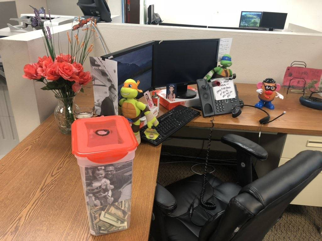 Eduardo Valtierrez's work desk is pictured on Saturday, Dec. 8, 2018, one day after the 25-year-old father died in a crash while on his way to work. The photo shows the school pictures of his 5-ye ...