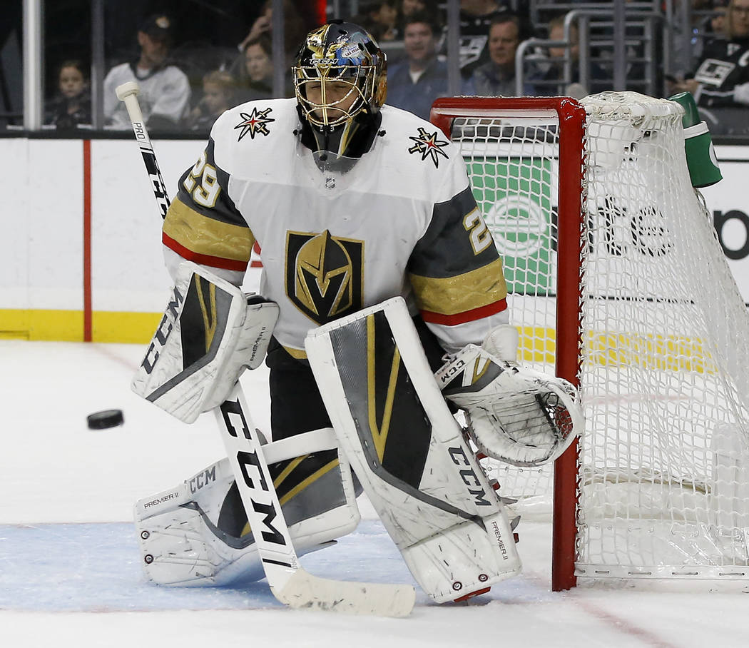 Vegas Golden Knights goaltender Marc-Andre Fleury blocks a shot by the Los Angeles Kings during the second period of an NHL hockey game in Los Angeles, Saturday, Dec. 8, 2018. (AP Photo/Alex Gallardo)