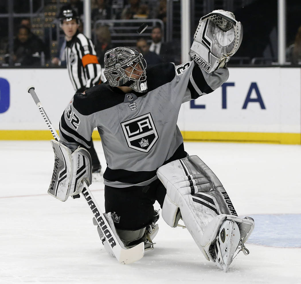 Los Angeles Kings goaltender Jonathan Quick deflects a shot by the Vegas Golden Knights during the first period of an NHL hockey game in Los Angeles, Saturday, Dec. 8, 2018. (AP Photo/Alex Gallardo)