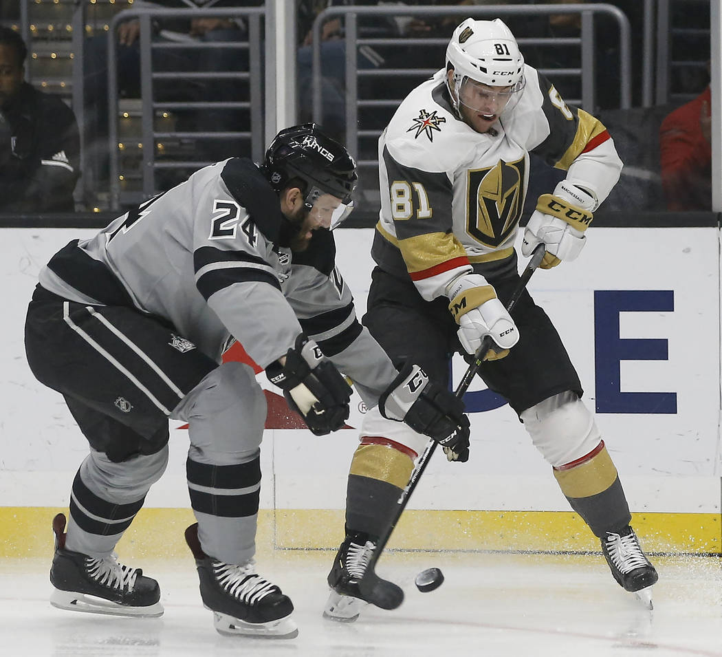 Vegas Golden Knights center Jonathan Marchessault, right, vies for the puck with Los Angeles Kings defenseman Derek Forbort, left, during the first period of an NHL hockey game in Los Angeles, Sat ...