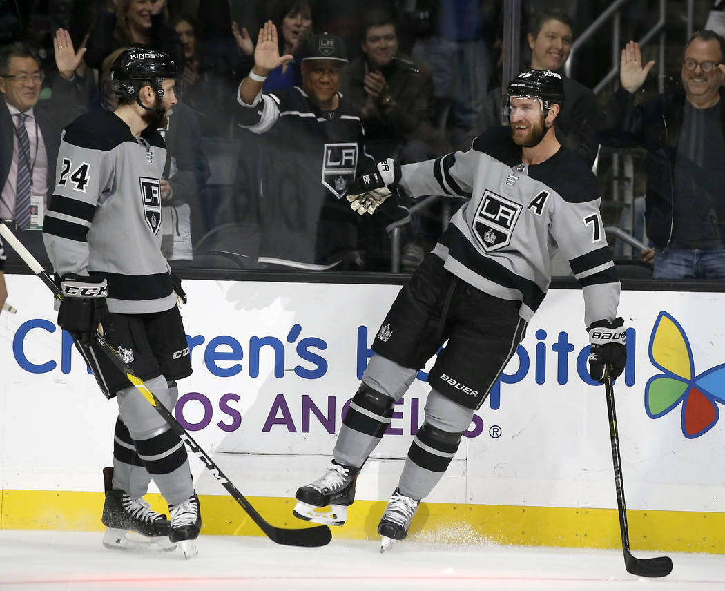 Los Angeles Kings center Jeff Carter, right, celebrates his goal with defenseman Derek Forbort, left, against the Vegas Golden Knights during the second period of an NHL hockey game in Los Angeles ...