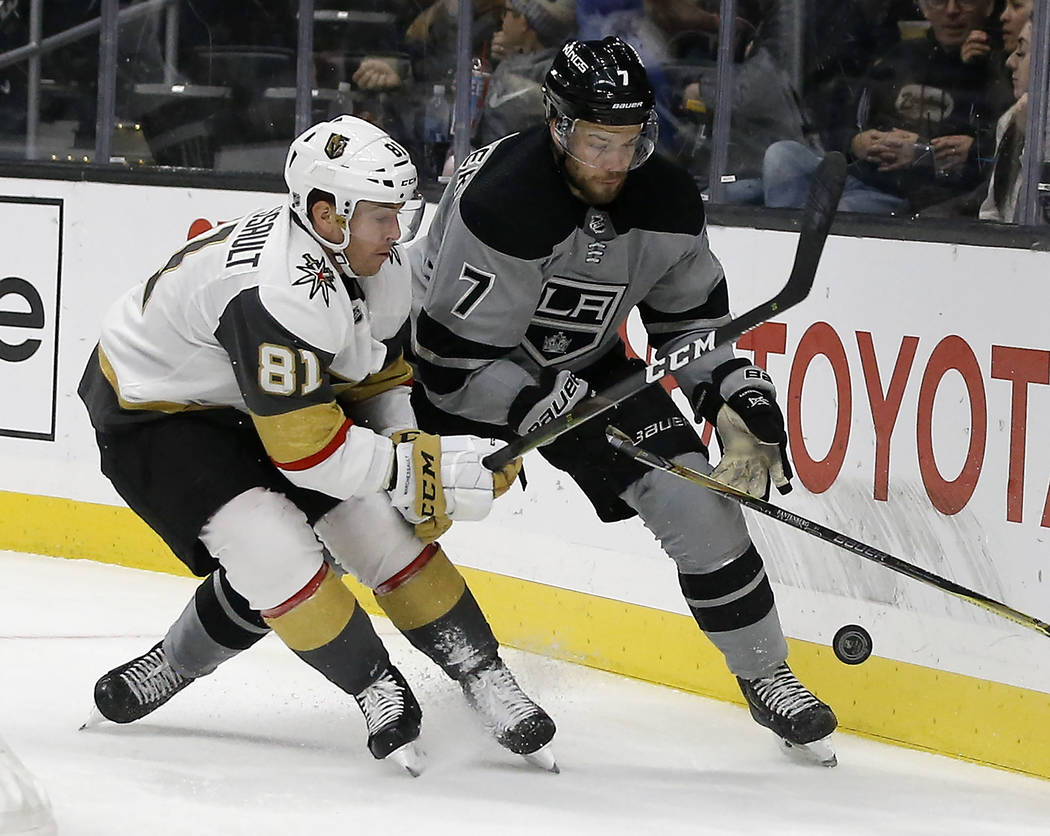 Vegas Golden Knights center Jonathan Marchessault, left, vies for the puck with Los Angeles Kings defenseman Oscar Fantenberg, right, of Sweden, during the first period of an NHL hockey game in Lo ...