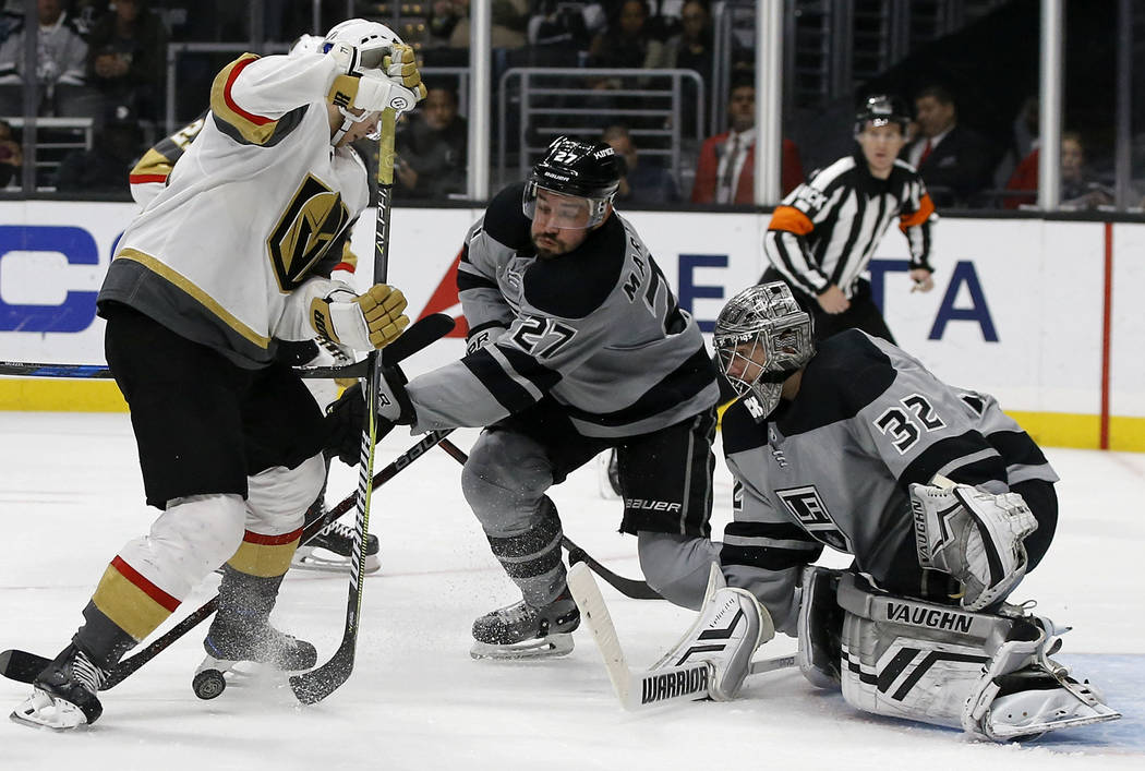 Vegas Golden Knights center William Karlsson, left, of Sweden, goes for the rebound with Los Angeles Kings defenseman Alec Martinez, center, and goaltender Jonathan Quick, right, defending during ...