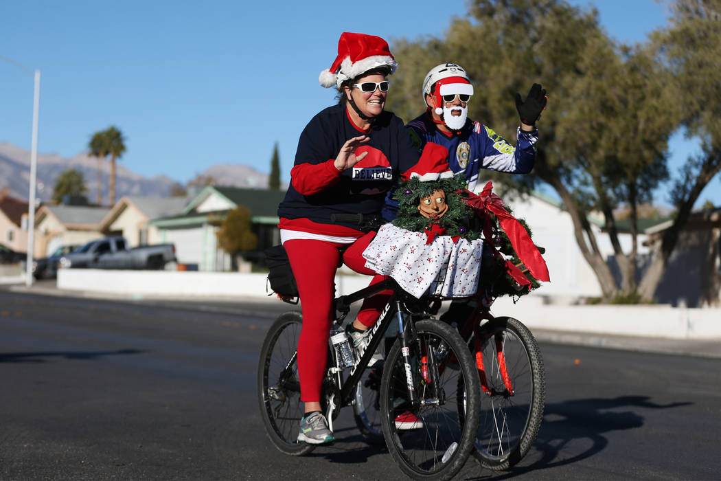 Theresa McAninch, left, and her husband Terry McAninch, ride together in the RTC for the Holiday Bike Ride in Las Vegas, Saturday, Dec. 8, 2018. People were allowed to participate in the event by ...