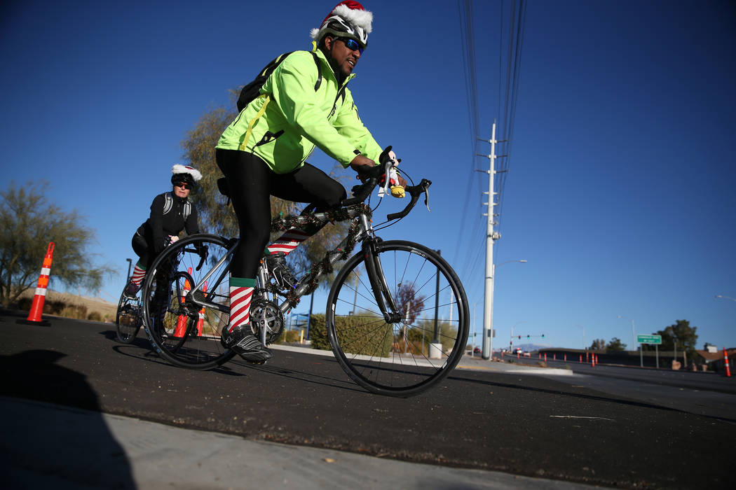 Bicyclists take off from the Westcliff Transit Center to start the RTC for the Holiday Bike Ride in Las Vegas, Saturday, Dec. 8, 2018. People were allowed to participate in the event by donating a ...