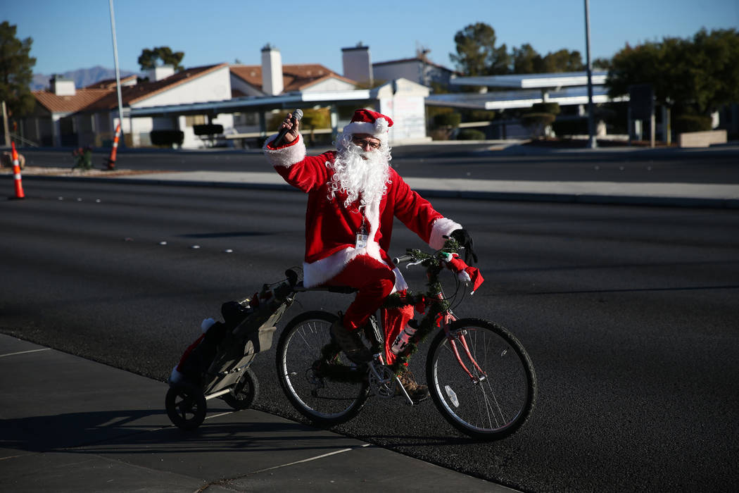 Ron Floth, bicycle outreach coordinator at Regional Transportation Commission of Southern Nevada, dressed as Santa Claus, leads a group of bicyclists during the RTC for the Holiday Bike Ride in La ...