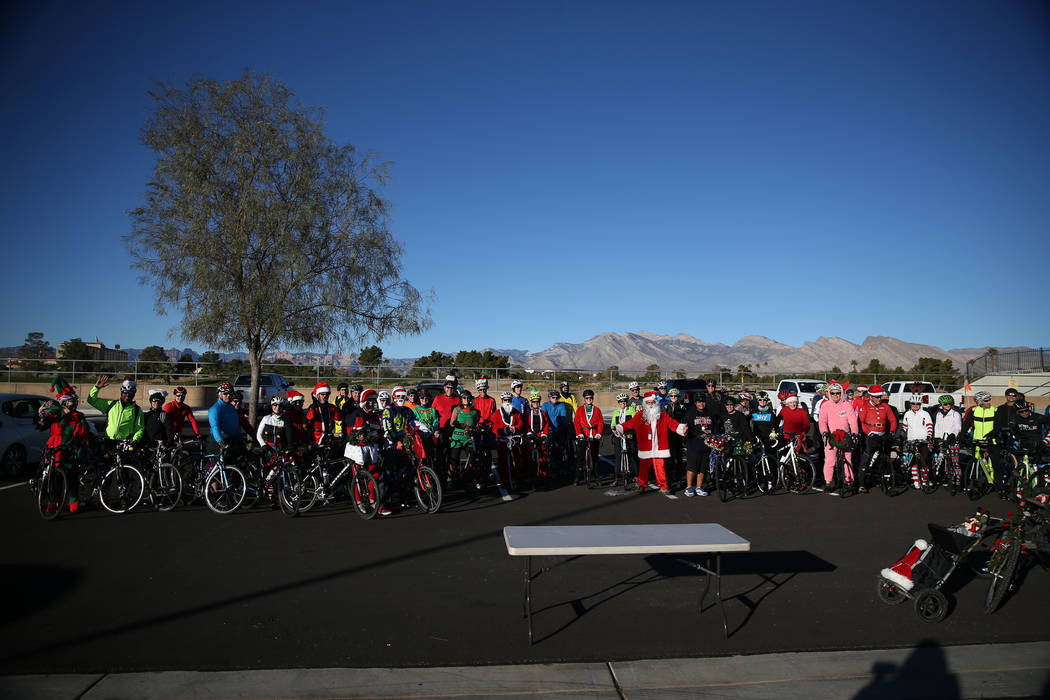 People pose for a photo before starting in the RTC for the Holiday Bike Ride in Las Vegas, Saturday, Dec. 8, 2018. People were allowed to participate in the event by donating a new unwrapped toy. ...