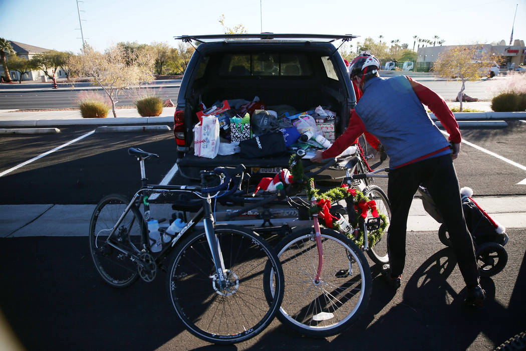 Toys are collected before the RTC for the Holiday Bike Ride in Las Vegas, Saturday, Dec. 8, 2018. People were allowed to participate in the event by donating a new unwrapped toy. Erik Verduzco Las ...
