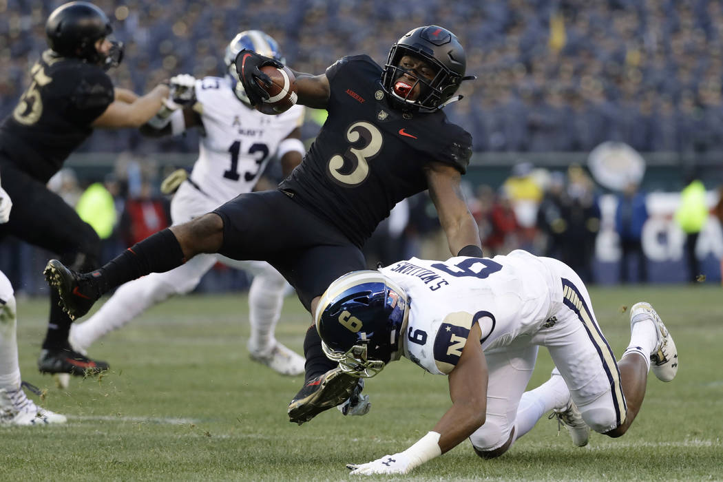 Army's Jordan Asberry, left, is tackled by Navy's Sean Williams during the first half of an NCAA college football game, Saturday, Dec. 8, 2018, in Philadelphia. (AP Photo/Matt Slocum)