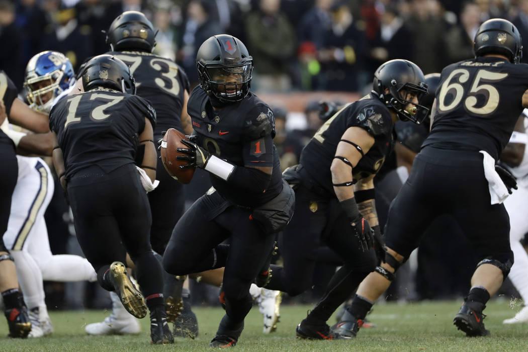 Army's Kelvin Hopkins Jr. drops back during the first half of an NCAA college football game against Navy, Saturday, Dec. 8, 2018, in Philadelphia. (AP Photo/Matt Slocum)