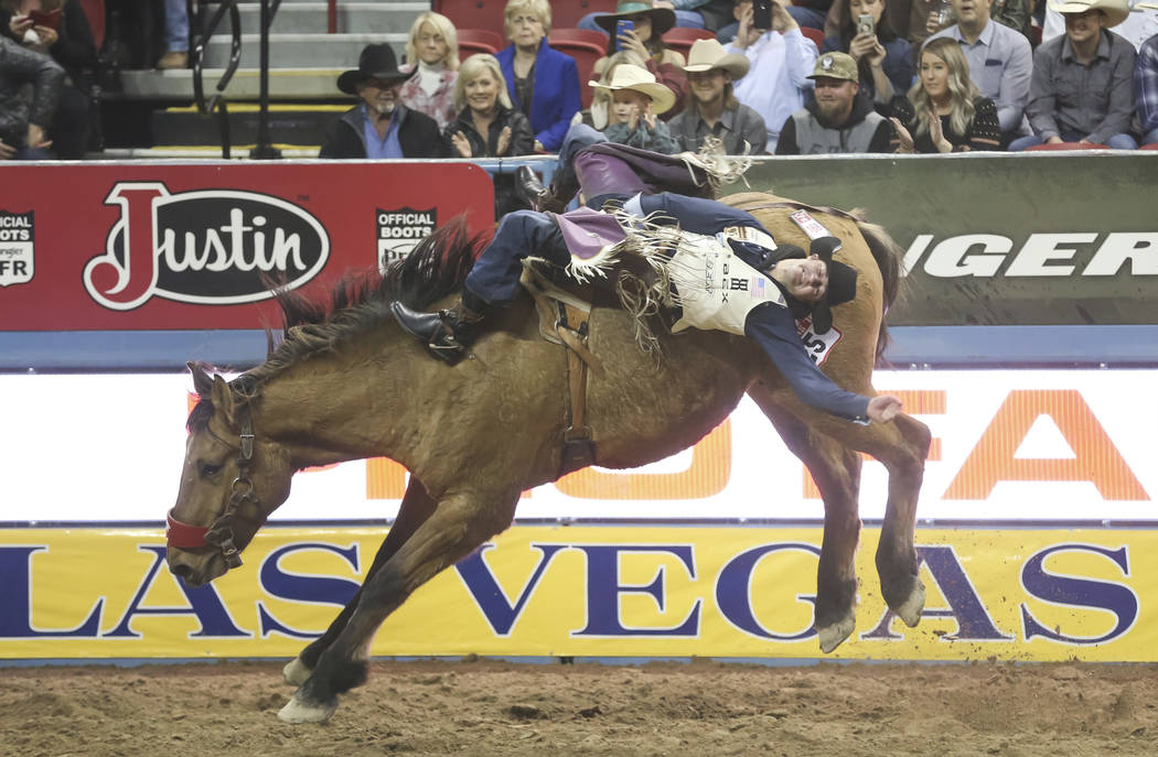 Kaycee Field of Spanish Fork, Utah competes in the bareback riding during the third go-round of the National Finals Rodeo at the Thomas & Mack Center in Las Vegas on Saturday, Dec. 8, 2018. Ri ...