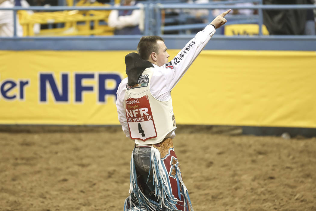 Tim O'Connell of Zwingle, Iowa points to the crowd after competing in the bareback riding the third go-round of the National Finals Rodeo at the Thomas & Mack Center in Las Vegas on Saturday, ...