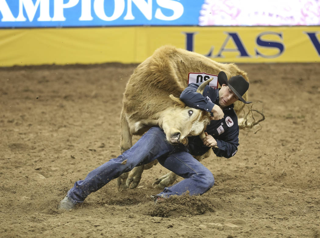 Scott Guenthner competes in the steer wrestling during the third go-round of the National Finals Rodeo at the Thomas & Mack Center in Las Vegas on Saturday, Dec. 8, 2018. Richard Brian Las Veg ...