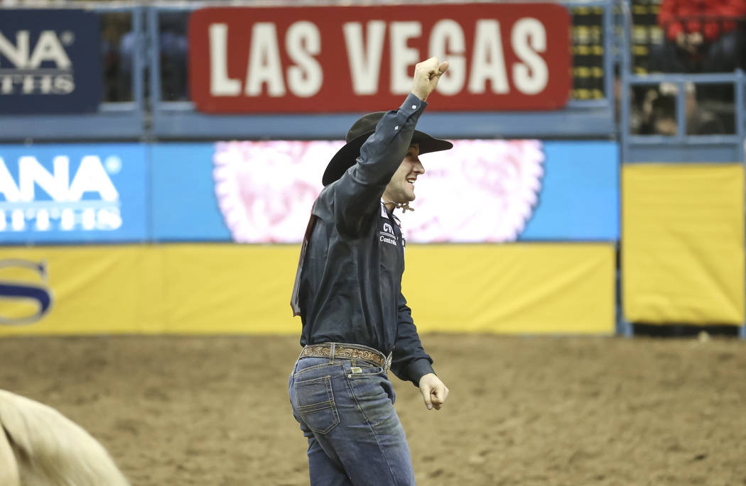 Scott Guenthner reacts after competing in the steer wrestling during the third go-round of the National Finals Rodeo at the Thomas & Mack Center in Las Vegas on Saturday, Dec. 8, 2018. Richard ...