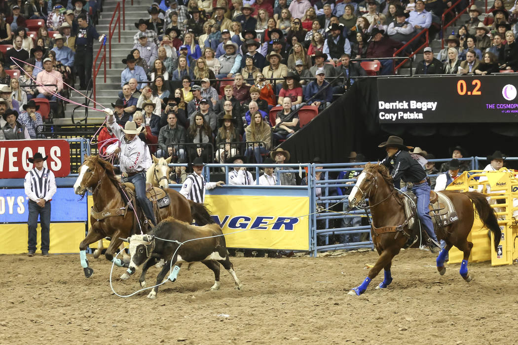 Derrick Begay, right, and Cory Petska compete in the team roping during the third go-round of the National Finals Rodeo at the Thomas & Mack Center in Las Vegas on Saturday, Dec. 8, 2018. Rich ...