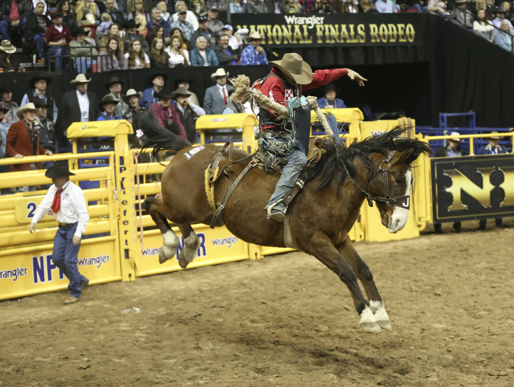 Isaac Diaz of Texas competes in the saddle bronc riding during the third go-round of the National Finals Rodeo at the Thomas & Mack Center in Las Vegas on Saturday, Dec. 8, 2018. Richard Brian ...