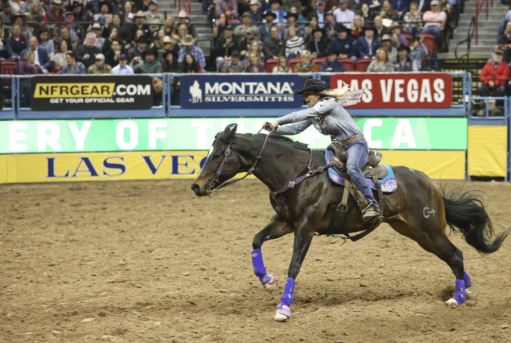 Amberleigh Moore of Oregon competes in the barrel racing during the third go-round of the National Finals Rodeo at the Thomas & Mack Center in Las Vegas on Saturday, Dec. 8, 2018. Richard Bria ...