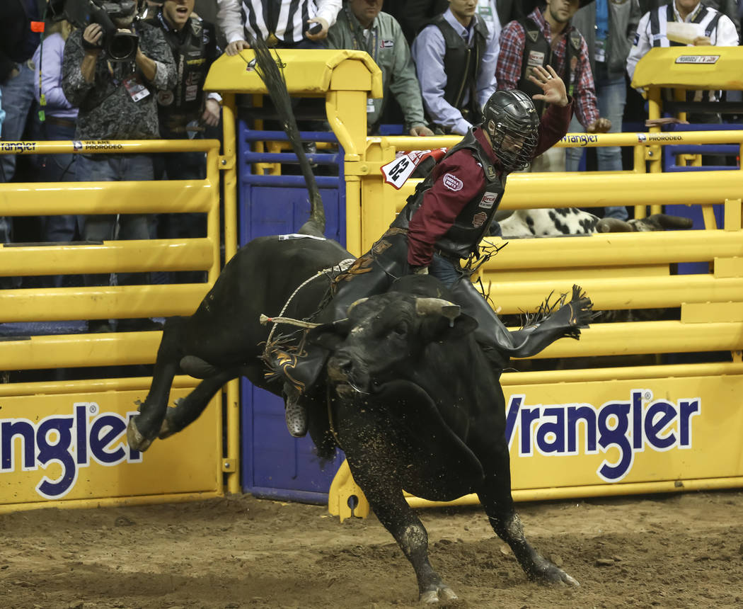 Tyler Bingham of Utah takes part in the bull riding competition during the third go-round of the National Finals Rodeo at the Thomas & Mack Center in Las Vegas on Saturday, Dec. 8, 2018. Richa ...
