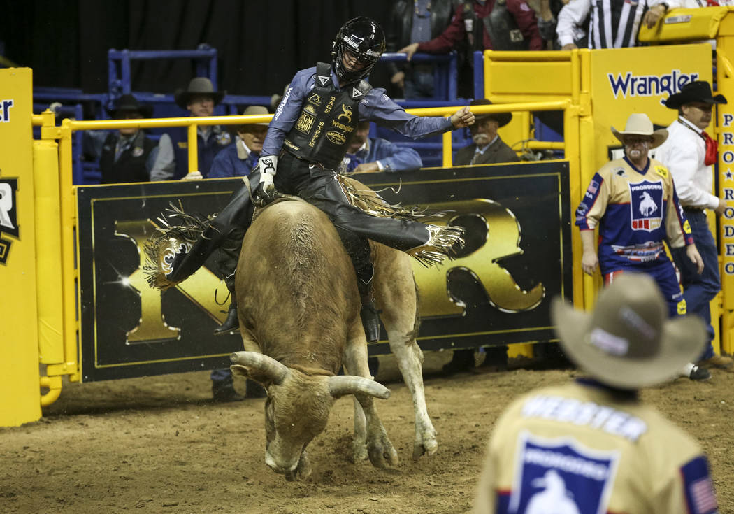 Sage Kimzey of Oklahoma takes part in the bull riding competition during the third go-round of the National Finals Rodeo at the Thomas & Mack Center in Las Vegas on Saturday, Dec. 8, 2018. Ric ...