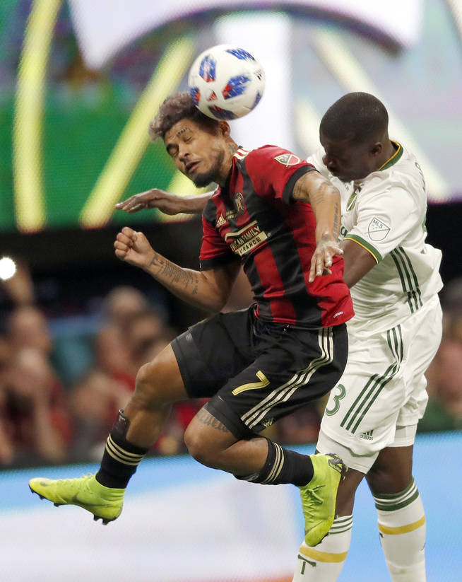 Atlanta United forward Josef Martinez (7) heads the ball against Portland Timbers defender Larrys Mabiala (33) during the first half of the MLS Cup championship soccer game, Saturday, Dec. 8, 2018 ...