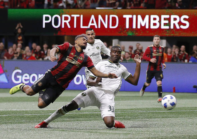 Atlanta United forward Josef Martinez (7) and Portland Timbers defender Larrys Mabiala (33) fight for the ball during the first half of the MLS Cup championship soccer game, Saturday, Dec. 8, 2018 ...