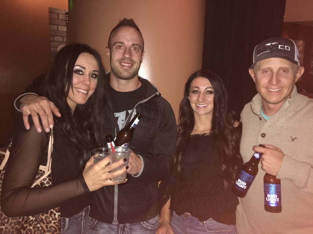 From left, Brittney Loosli, Justin Jensen, Julie Sutton and Robbie Sutton mug for the camera during the Wrangler NFR viewing party at the Honky Tonk Saloon inside The Orleans. Patrick Everson/Revi ...