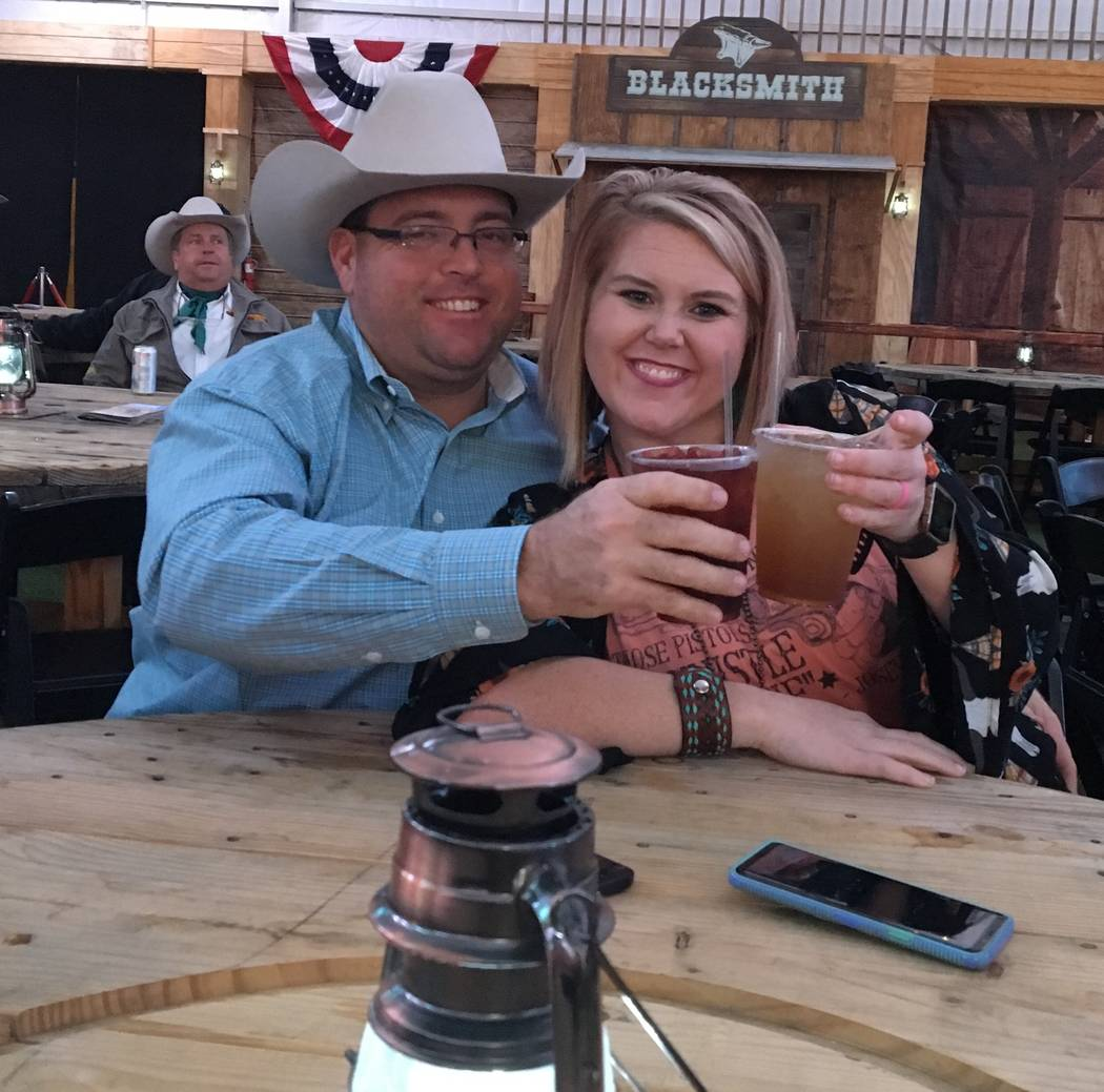 Tater and Courtney Wilbanks of Beebe, Ark., raise a toast to the rodeo while gearing up for Friday night's Wrangler NFR viewing party at the Downtown Las Vegas Events Center. The venue is one of m ...