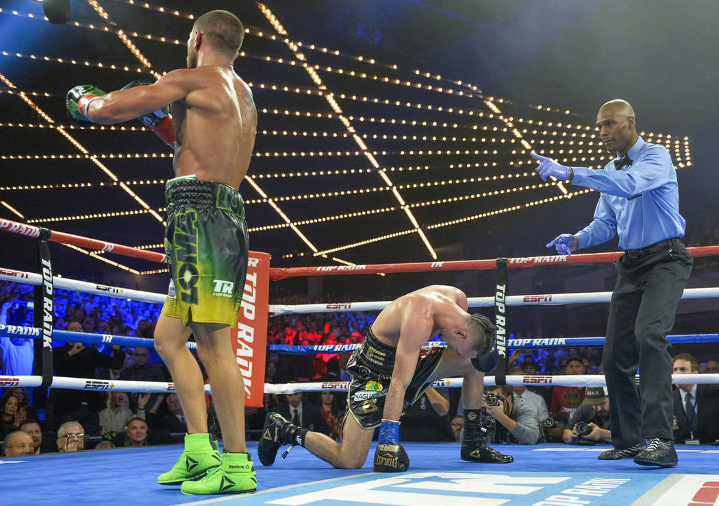 Vasiliy Lomachenko heads to a neutral corner after a second knockdown of Jose Pedraza in the 11th round of the WBO title lightweight boxing match at Madison Square Garden, Saturday, Dec. 8, 2018, ...
