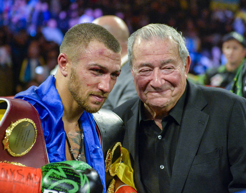 Vasiliy Lomachenko poses with promoter Bob Arum after defeating Jose Pedraza in the WBO title lightweight boxing match at Madison Square Garden, Saturday, Dec. 8, 2018, in New York. (AP Photo/Howa ...