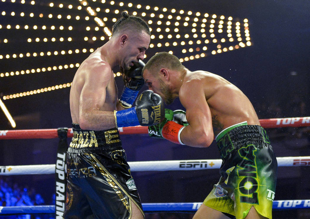 Vasiliy Lomachenko right, tries to tries to avoid a punch from Jose Pedraza in the WB lightweight title boxing match at Madison Square Garden, Saturday, Dec. 8, 2018, in New York. (AP Photo/Howard ...