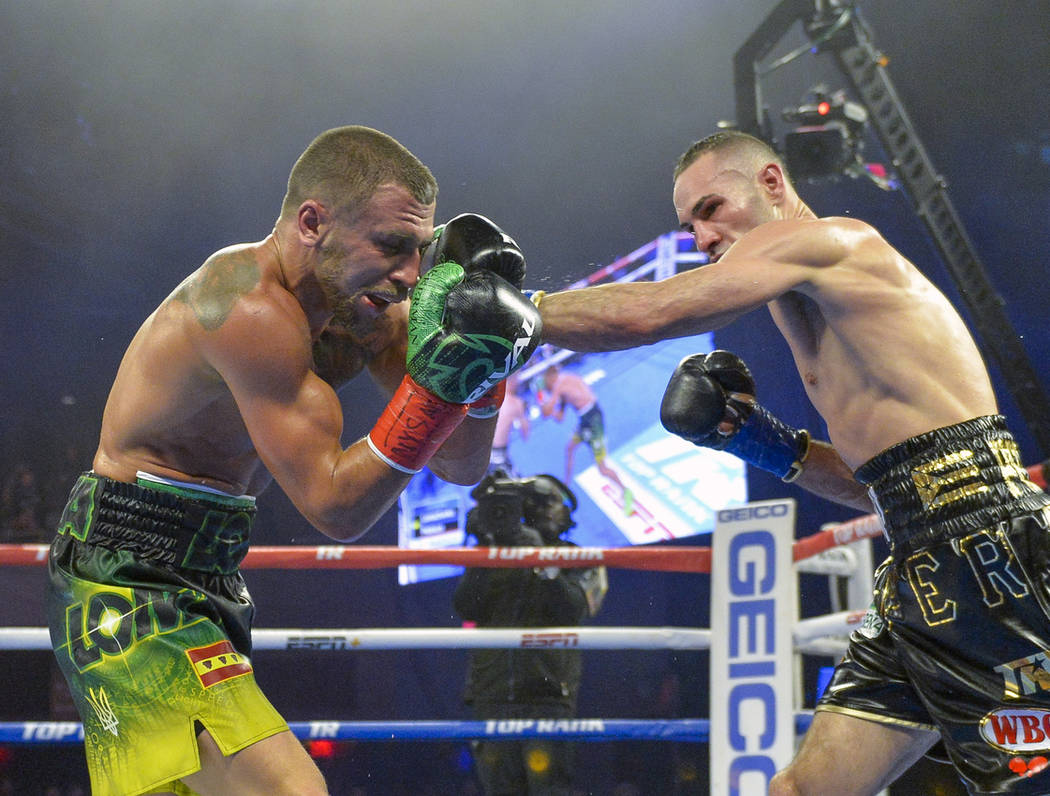 Jose Pedraz, right, lands a punch against Vasiliy Lomachenko in lightweight boxing match at Madison Square Garden, Saturday, Dec. 8, 2018, in New York. (AP Photo/Howard Simmons)
